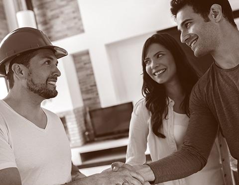 TM Builders Whistler Process couple handshaking builders hand